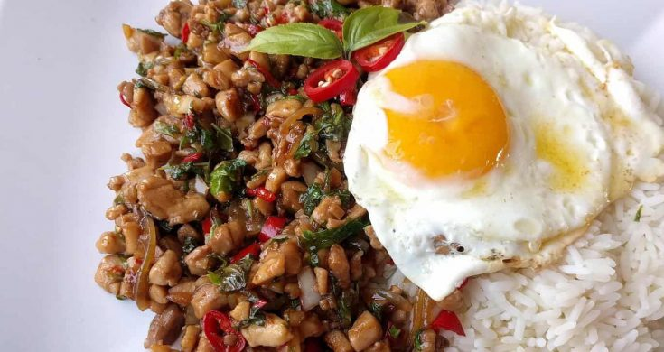 Pad Kra Pao Gai is a delicious Thai Street Food delight that translates to Holy Basil Chicken. There are a million tasty reasons why this dish is so incredibly popular but the fact it can be ready in 10-15 minutes is a major plus factor!
