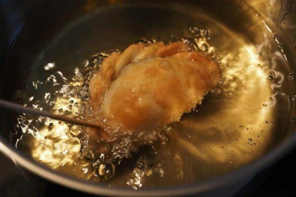 Malaysian Karipap Ayam Being Fried